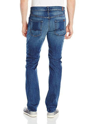 Size: 32 50% Cotton/42% Lyocell/6% Polyester/2% Spandex Made in the USA or Imported Button closure Machine Wash Five-pocket jean in medium wash featuring contoured waistband and fading at front - 2